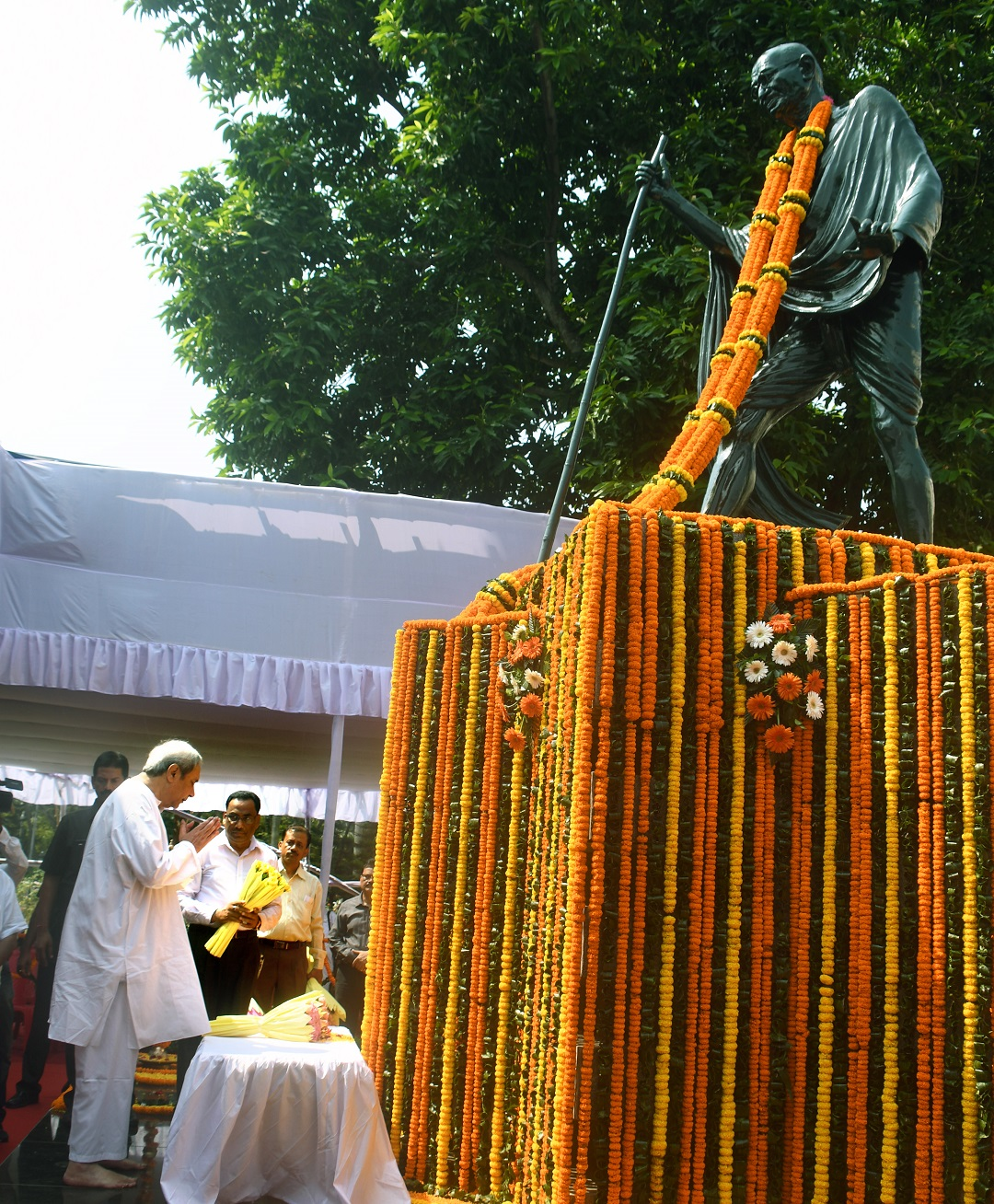 Chief Minister Shri Naveen Patnaik paying floral tribute to Father of Nation Mahatma Gandhi on State level Gandhi Jayanti at OLA premises